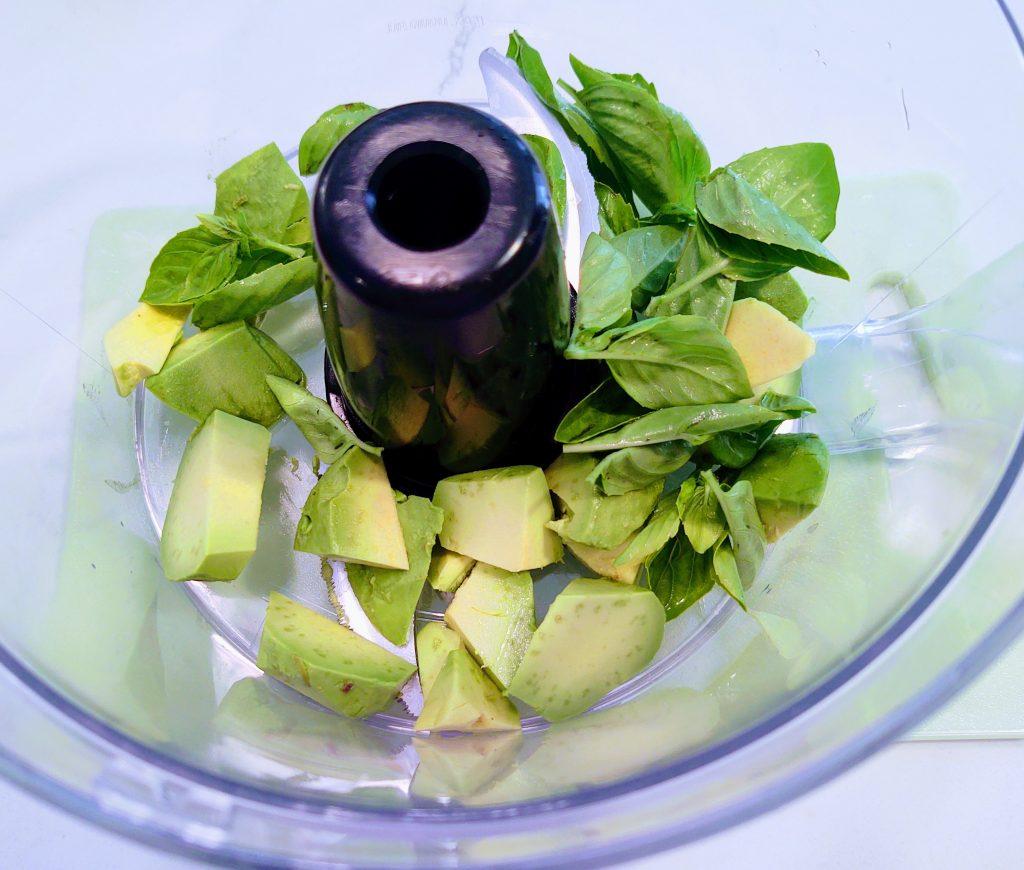 Basil and avocado in food processor